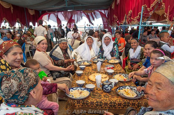 Ladies enjoying plov and the companionship of a desert festival