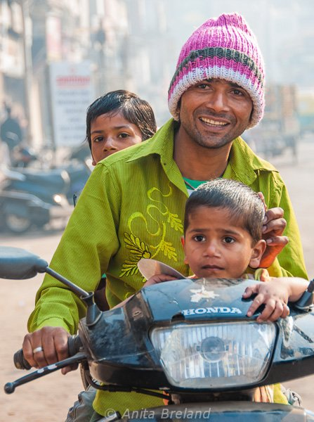 Dad and kids on a motorcycle, Ahmedabad